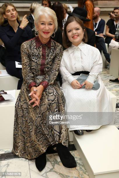 Helen Mirren and Sinead Burke attend the Victoria Beckham show during London Fashion Week September 2019 at British Foreign and Commonwealth Office...