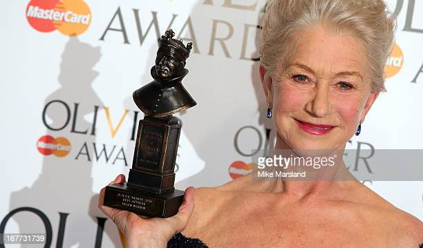 Helen Mirren poses in the press room at The Laurence Olivier Awards at The Royal Opera House on April 28 2013 in London England