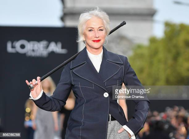 Helen Mirren walks the runway during the Le Defile L'Oreal Paris show as part of the Paris Fashion Week Womenswear Spring/Summer 2018 on October 1...
