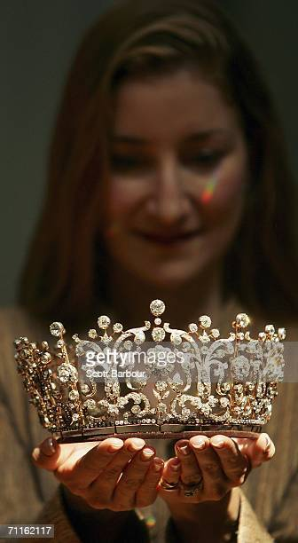 Helen Molesworth a jewellery specialist from Christie's holds the 'Poltimore Tiara' during a photocall of jewellery and works of art from the...
