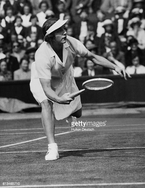 Helen Moody reaches for the ball during a match against Britain's Miss Stammers in the 1938 Wightman Cup at Wimbledon which America went on to win