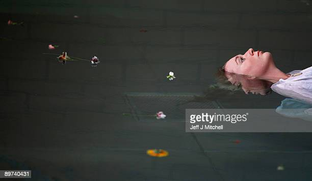 Helen Morton of the Three Bugs Fringe Theatre company performs Ophelia drowning during the Edinburgh Fringe Festival at the Apex Hotel swimming pool...