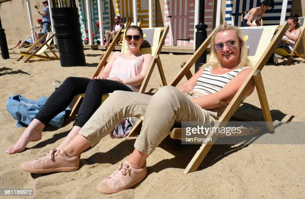 Helen Moule, 23 and Eliza Fleming sit in deck chairs waiting for the launch of the Great Exhibition of the North on June 22, 2018 in Newcastle Upon...