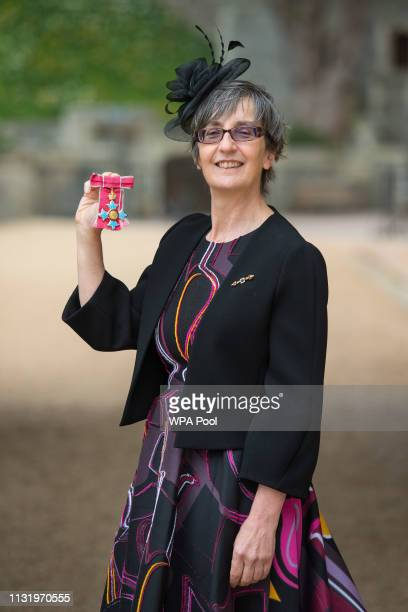 Helen Pankhurst with her CBE medal awarded by Queen Elizabeth II at an investiture ceremony at Windsor Castle on March 22 2019 in Windsor England