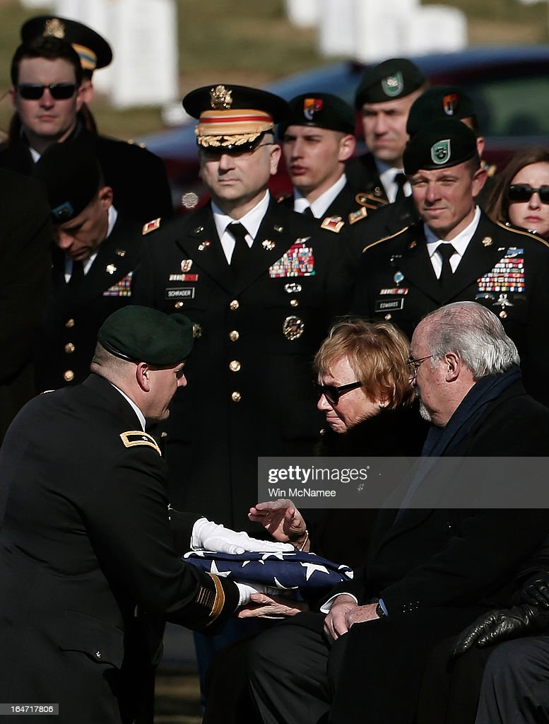 Helen Pedersen-Keiser is presented the American flag that covered her son's casket by Brig. Gen. Christopher K. Haas, commander, U.S. Special Forces Command, during a burial service for her son, U.S. Army Capt. Andrew Pedersen-Keel at Arlington National Cemetery March 27, 2013 in Arlington, Virginia. Capt. Pedersen-Keel was killed on March 11, 2013 while serving in Wardak Province, Afghanistan from injuries sustained when attacked by small arms fire from a man in an Afghan police uniform, according to reports.