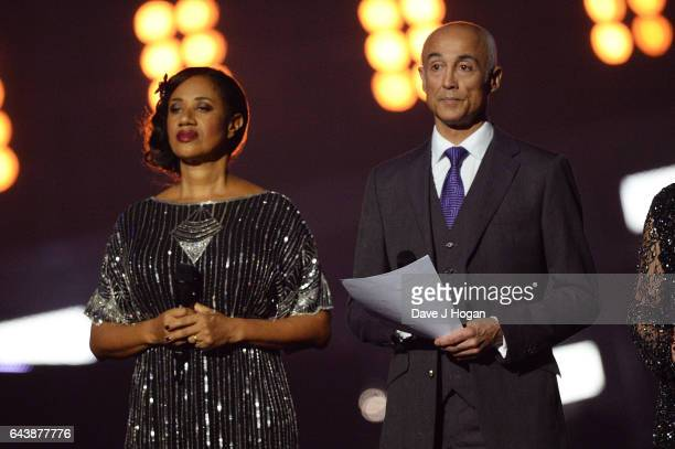 """Helen """"Pepsi"""" DeMacque and Andrew Ridgeley speak on stage at The BRIT Awards 2017 at The O2 Arena on February 22, 2017 in London, England."""