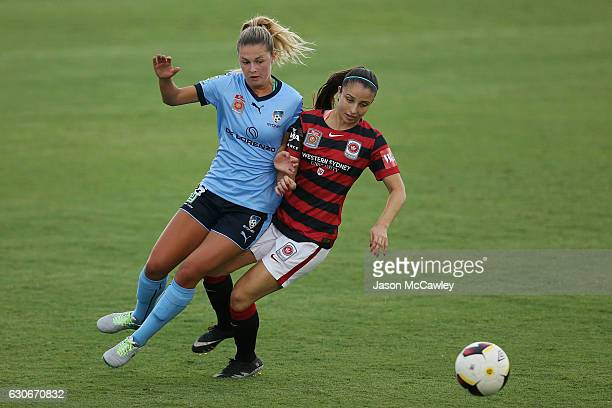 Helen Petinos of the Wanderers is challenged by Hannah Bacon of Sydney during the round nine WLeague match between Western Sydney and Sydney at...