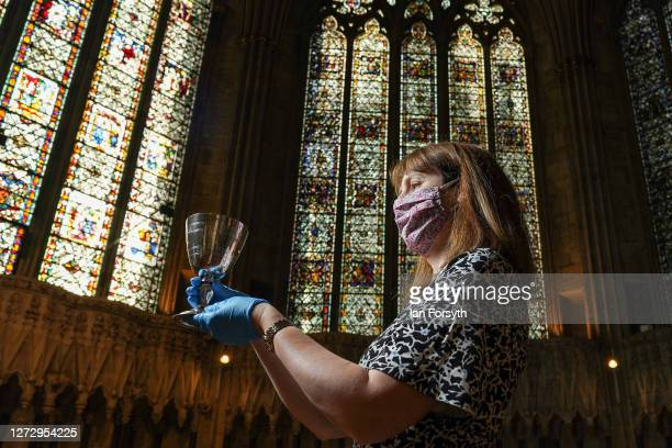 Helen Rawson Head of Heritage at York Minster poses with a silver chalice given to the Minster in 1919 in memory of World War One soldier CL Bentley...