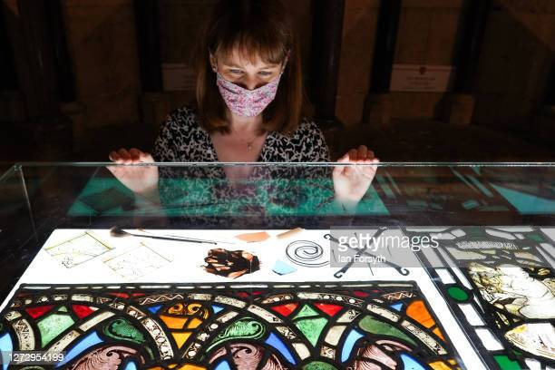 Helen Rawson Head of Heritage at York Minster poses with one of the oldest stained glass panels in Europe and which is displayed at a media preview...