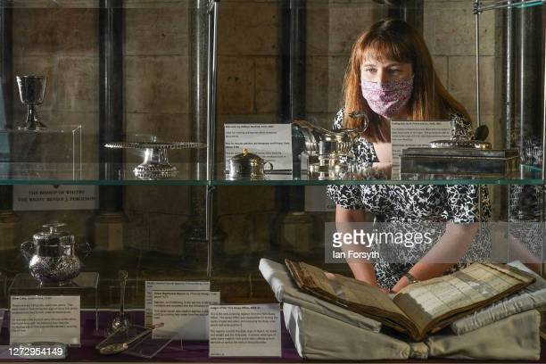 Helen Rawson Head of Heritage at York Minster poses with ornate 14th century silver artifacts displayed at a media preview of a new exhibition...