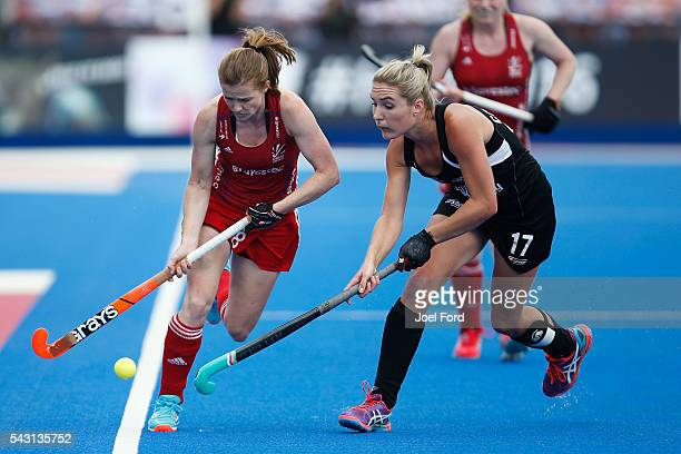 Helen Richardsen Walsh of Great Britain and Sophie Cocks of New Zealand fight for the ball during the FIH Women's Hockey Champions Trophy 2016 match...