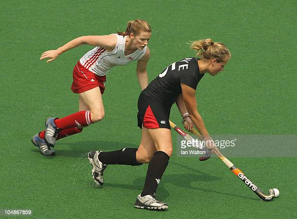 Helen Richardson of England tries to tackle Abigail Raye of Canada during the preliminary pool B match between Canada and England in the Hockey at...