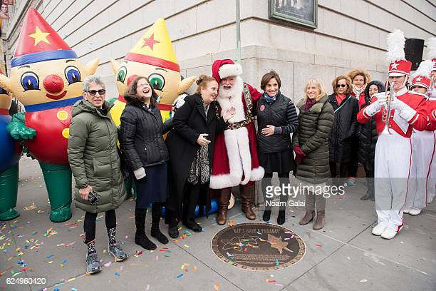 Helen Rosenthal Gale A Brewer Santa Claus Amy Kule and Louise Mirrer attend the unveiling of the 90th Macy's Thanksgiving day parade plaque on...