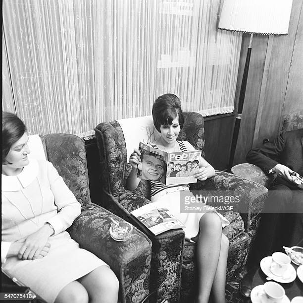 Helen Shapiro reads a magazine in a hotel in Manchester United Kingdom 1965