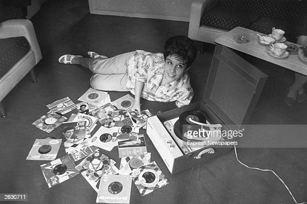 Helen Shapiro the pop singer who had greatest success in the early 60's lying on the floor playing records on her Dansette gramophone player