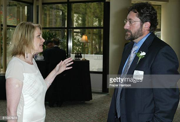Helen Shaver of Joan of Arcadia talks to Bob Peterson writer Finding Nemo at The Humanitas Prize Awards at the Universal Hilton Hotel on July 8 2004...