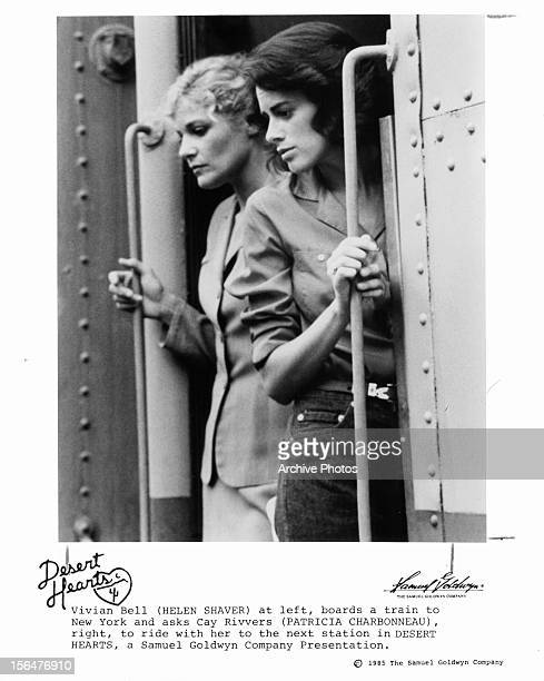 Helen Shaver rides a train with Patricia Charbonneau in a scene from the film 'Desert Hearts' 1985