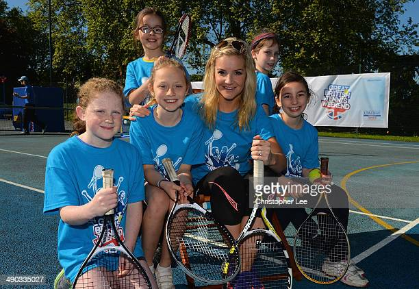 Helen Skelton poses for the camera with young tennis fans from Will to Win Tennis Club during The Great British Tennis Weekend Launch at Will to Win...