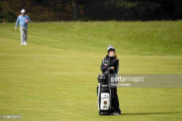 Helen Storey caddie for Lee Westwood of England waits on the 17th fairway during Day Two of the Betfred British Masters at Hillside Golf Club on May...