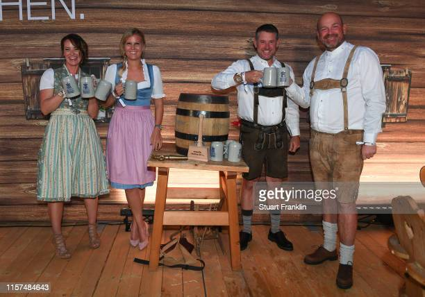 Helen Storey Grace Barber Lee Westwood of England and Thomas Bjorn of Denmark pose for a picture at the BMW players night day two of the BMW...