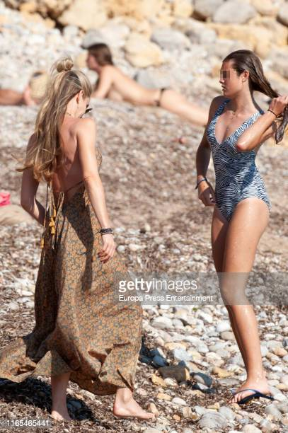 Part of this image has been pixellated to obscure the identity of the child Helen Svedin and Stella Figo are seen on July 16 2019 in Ibiza Spain