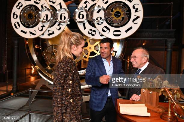 Helen Svedin Luis Figo and IWC watchmaker Kurt Klaus visit the IWC booth during the Maison's launch of its Jubilee Collection at the Salon...