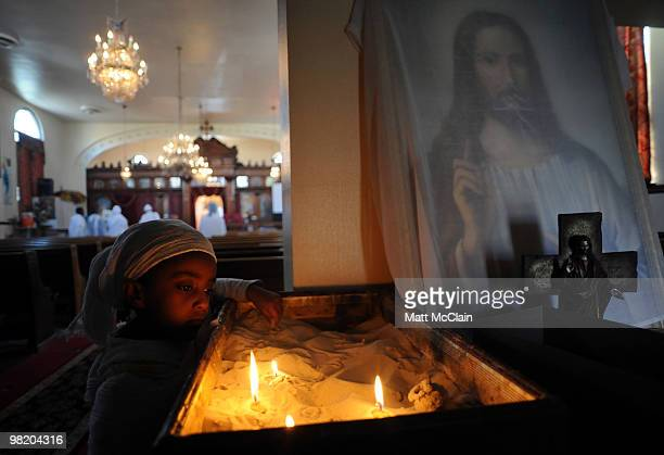 Helen Tesfay stares at lit candles at the Ethiopian Orthodox Church April 1 2010 in Denver Colorado Members of the Ethiopian Orthodox Church...