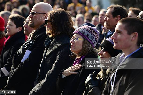 Helen Thorpe former wife of John Hickenlooper listens to the invocation during the inauguration ceremony of the governor at the state capitol in...