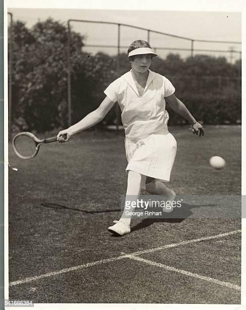 Helen Wills America's foremost tennis player who was incapacitated by recent illness from competing in the Wimbledon Tournament is seen conditioning...
