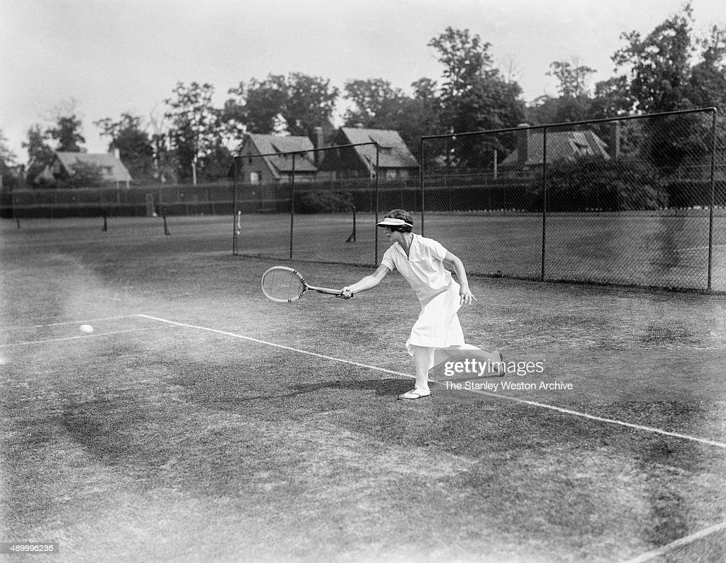 Helen Wills is shown here striking a ball while playing tennis circa 1925.