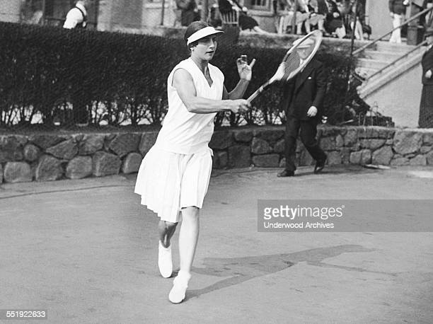 Helen Wills Moody begins a two week practice session at the West Side Tennis Club on Long Island before sailing to Europe to defend her Wimbledon and...