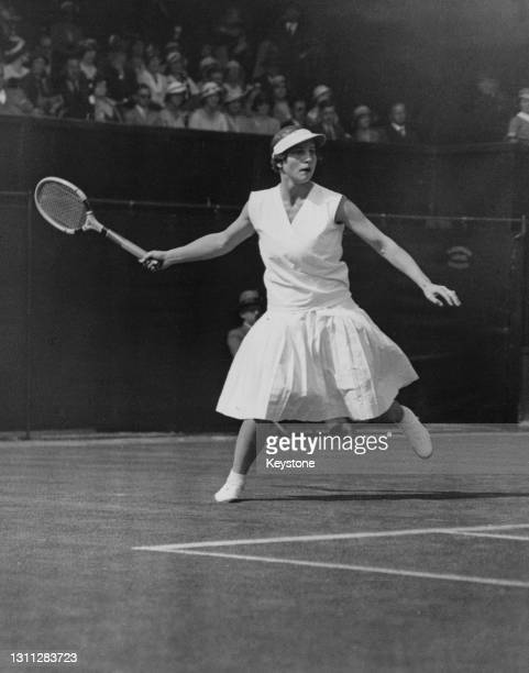 Helen Wills Moody of the United States makes a backhand return to compatriot Helen Jacobs during their Women's Singles Final match at the Wimbledon...