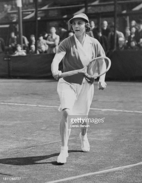 Helen Wills Moody of the United States reaches to make a backhand return during a Women's Singles match at the North London Hard Courts Tennis...