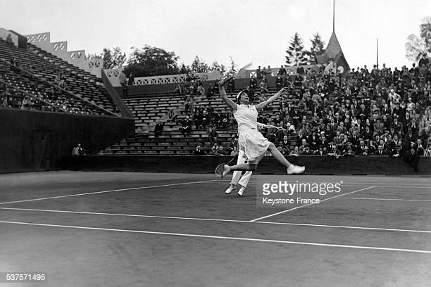 Helen Wills with his partner Elizabeth Ryan during the ladies' doubles' final at Roland Garros stadium on May 29 1932 in Paris France
