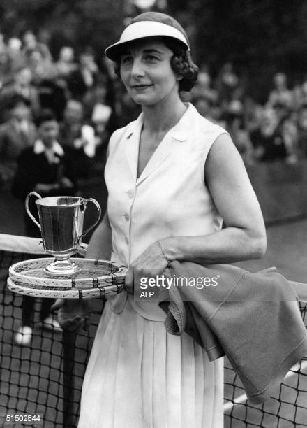 Helen WillsMoody of the US poses with her trophy 14 May 1938 after beating ES Law 62 75 in the final of the women's singles of the North London Hard...