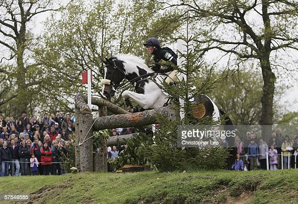Helen Wilson of Great Britain riding Tip Top Tiger clears the jump before she loses her seating and falls off during the Cross Country Event...