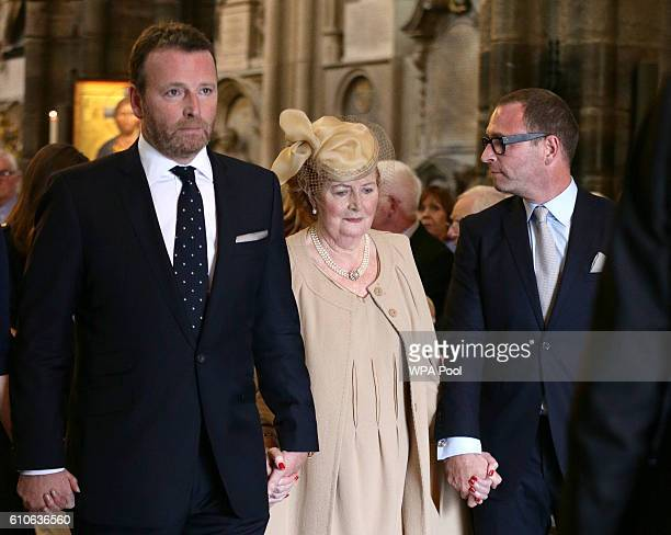 Helen Wogan the widow of Sir Terry Wogan walks with their sons Alan and Mark as they leave Westminster Abbey during a memorial service for the late...