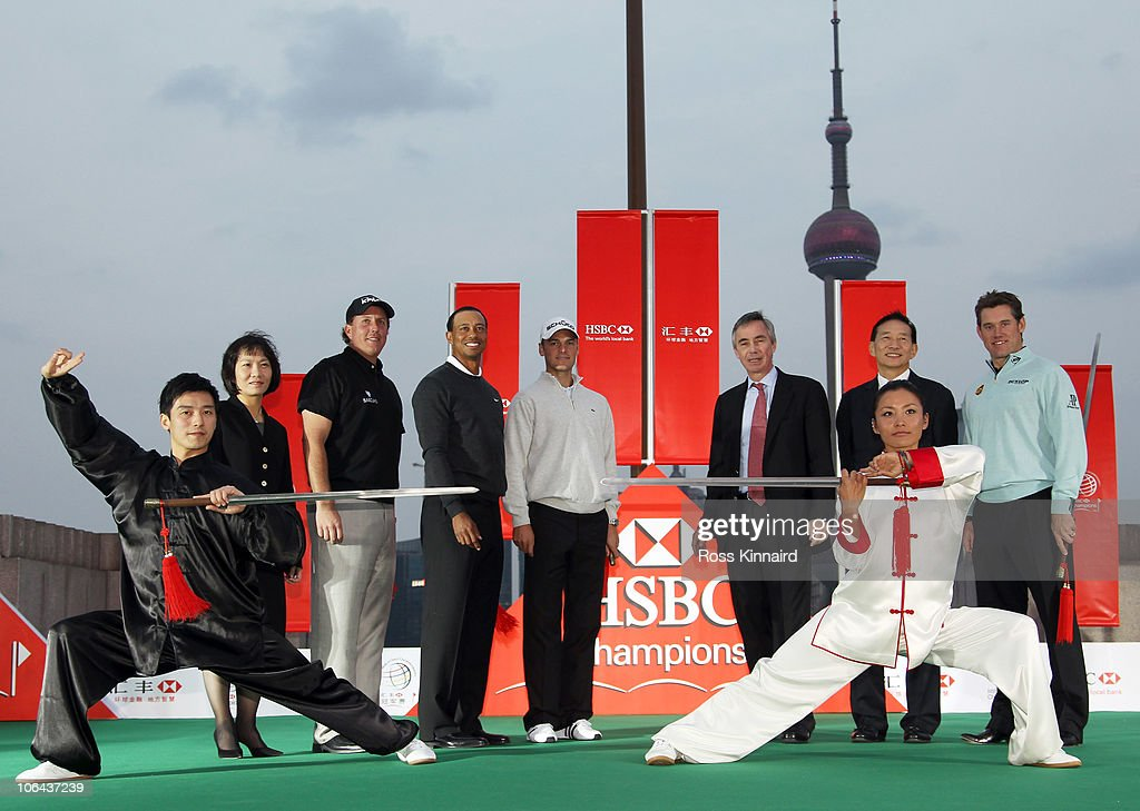 Helen Wong (President and CEO, HSBC China), Phil Mickelson of the USA, Tiger Woods of the USA, Martin Kaymer of Germany, Sandy Flockhart (Executive Director, HSBC Holdings), Peter Wong (CEO, HSBC Asia-Pacific) and Lee Westwood of England during the 2010 WGC-HSBC Champions Photocall at The Peninsula hotel on The Bund, Shanghai on November 2, 2010 in Shanghai, China.