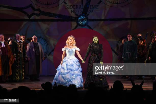 Helen Woolf and Nikki Bentley bow at the curtain call as hit musical Wicked celebrates 13 years at London's Apollo Victoria Theatre on September 26...