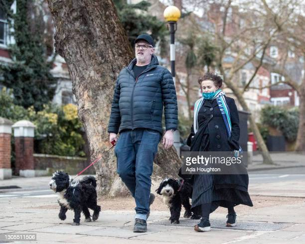 Helena Bonham Carter and Greg Davies seen walking their dogs through Hampstead on March 05, 2021 in London, England.