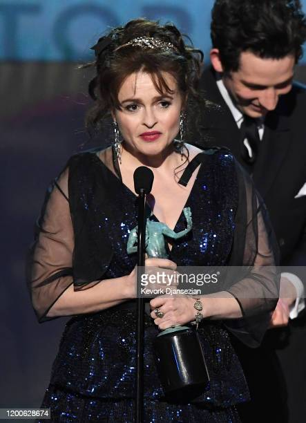 Helena Bonham Carter and Josh O'Connor accept Outstanding Performance by an Ensemble in a Drama Series for 'The Crown' onstage during the 26th Annual...
