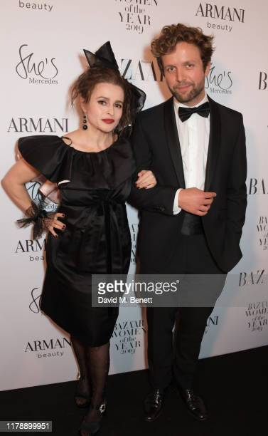 Helena Bonham Carter and Rye Dag Holmboe attend the Harper's Bazaar Women of the Year Awards 2019 in partnership with Armani Beauty at Claridge's...