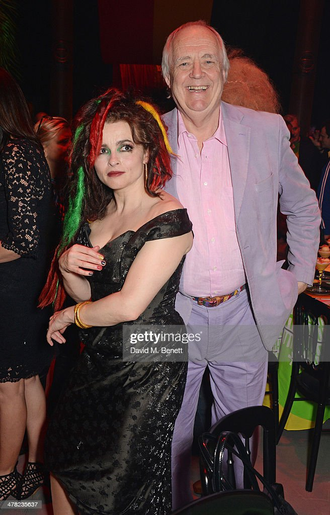 Helena Bonham Carter (L) and Sir Tim Rice attend 'A Night of Reggae' hosted by Helena Bonham Carter for Save The Children UK at The Roundhouse on March 12, 2014 in London, England.