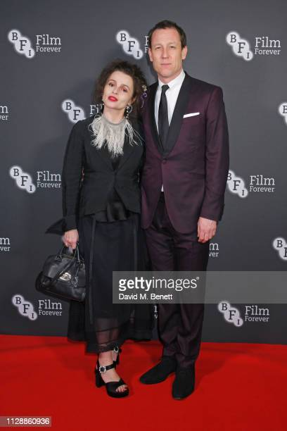 Helena Bonham Carter and Tobias Menzies attend the BFI Chairman's Dinner honouring Olivia Colman with the BFI Fellowship at Rosewood London on March...