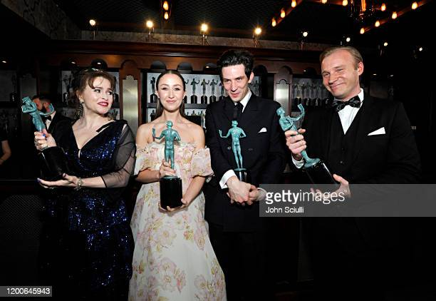 Helena Bonham Carter Erin Doherty Josh O'Connor and Sam Phillips winners of Outstanding Performance by an Ensemble in a Drama Series pose in the...
