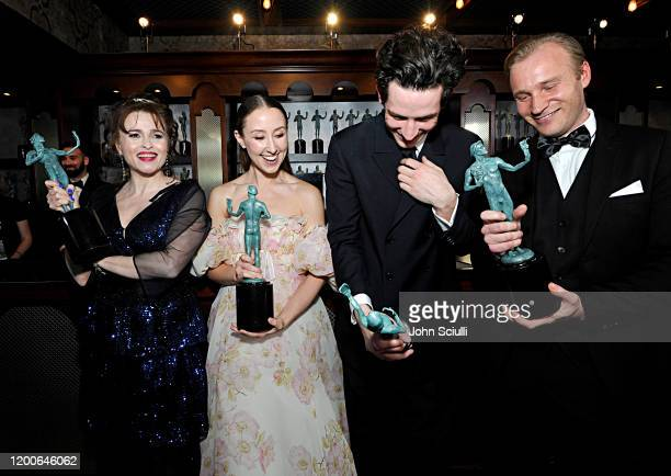 Helena Bonham Carter, Erin Doherty, Josh O'Connor and Sam Phillips, winners of Outstanding Performance by an Ensemble in a Drama Series pose in the...