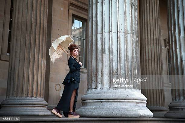 Helena Bonham Carter holds her original parasol from 'A Room With a View' as she attends a photocall to launch BFI Love at The British Museum on...