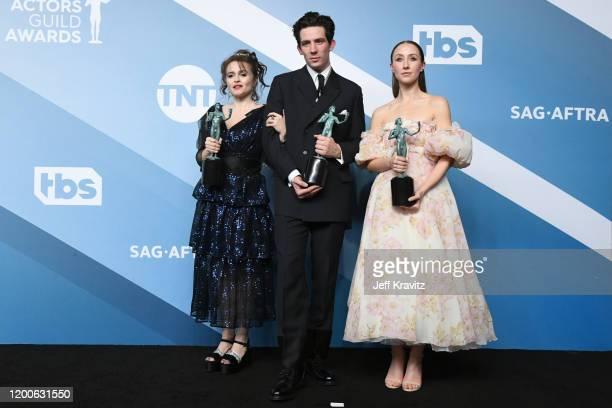 Helena Bonham Carter Josh O'Connor and Erin Doherty pose with the trophy for Outstanding Performance by an Ensemble in a Drama Series for The Crown...