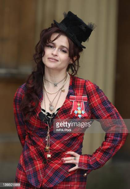 Helena Bonham Carter poses with her Commander of the British Empire medal after an Investiture ceremony at Buckingham Palace on February 22 2012 in...