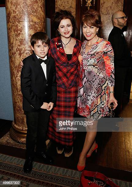 Helena BonhamCarter and her son Billy Raymond Burton and Kathy Lette attends a drinks reception prior to a special screening of David Attenborough's...
